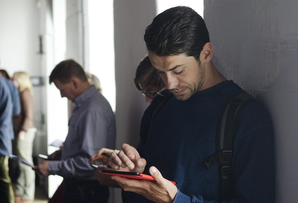man with iPad